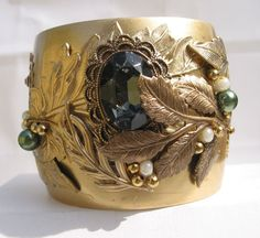 This brass cuff is 5 3/4 around with a 1 inch opening and this cuff is 2 wide. My Under the Leaves design is made with beautiful brass leaves partially