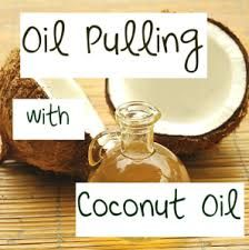 Oil pulling with coconut oil. A natural and traditional way of whitening teeth and boosting oral health.
