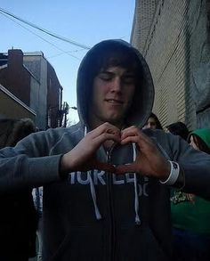 Zach Merrick trying to figure out how to make a heart..Hes cute when hes confused right? right!