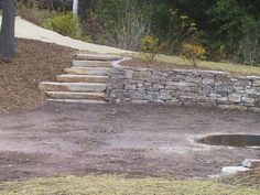 Curving limestone retaining wall with steps in Sturgeon Bay, Wisconsin.
