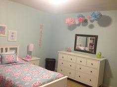 Maddy's completed light blue/pink big girl room.  Pottery Barn Brooklyn bedding.  Paper pom poms.  Chevron light pink curtains, rug, and lamp.  Etsy prints.  IKEA Hemnes bedroom set.