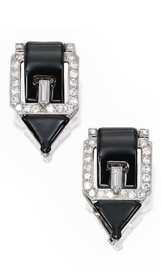 *PAIR OF PLATINUM, DIAMOND AND ENAMEL CLIP-BROOCHES, CHARLTON & CO. Designed as buckles applied with black enamel, set with round, square and bullet-shaped diamonds, both signed Charlton; circa 1925.