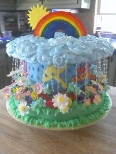 April Showers May Flowers By Toster on CakeCentral.com would also be a cute baby shower cake