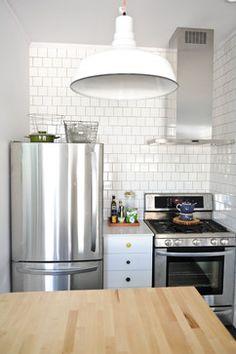 Houzz Small Kitchens | white cabinet between fridge and range