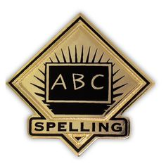 "School Pin - Spelling. 1"" Gold plated with black enamel. $3.95"