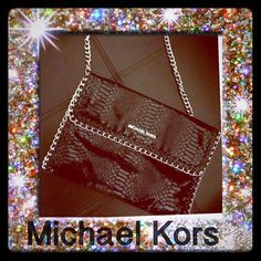Stunning Michael Kors Chelsea Python clutch Stunning oversized clutch with detachable strap. This is a very versatile shoulder bag that can also be held as a clutch. No need for a wallet with all of the interior slots.  You will love it. Non smoker. Michael Kors Bags Shoulder Bags