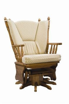 Virginia Upholstered Gliding Swivel Rocking Chair from DutchCrafters Amish Furniture. Solid wood, country-style swivel glider great for a living room or nursery. Features upholstered high seat and back. Made to order in the U.S.A. in your choice of wood type, finish, and hardware from a variety of options. #swivelgliderchair #swivelgliderchairlivingroom #livingroom #nursery