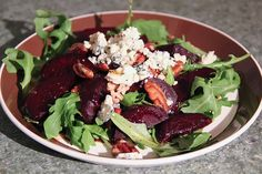Roasted beet salad, blue cheese, candied pecans and arugula salad.