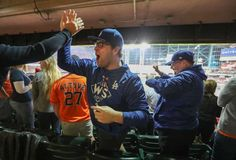 October 28, 2017:  Game 4 of World Series.  Los Angeles Dodgers and Houston Astros, 6 to 2, Dodgers. Dodgers fans Ryan Daly and his father, John (right), celebrate after LA's Joc Pederson hit a homer in the 9th inning of World Series Game 4 Saturday, Oct. 28, 2017, in Houston.
