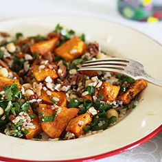 Nutty brown rice salad with chickpeas, toasted pecans, roast sweet potato, herbs and a sweet balsamic dressing