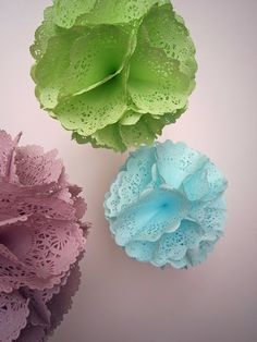 Dying Paper Doilies...here  Link...on how to make the actual pom poms here....http://ritafisher.blogspot.com/2011/06/doily-pom-poms-tutorial.html
