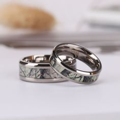 The ring is made of lighter, weightless high-tech titanium than stainless steel or tungsten crystals.The Camouflage inlay is the perfect backdrop for the ring,which is and wide and is perfect for couples who want to match the ring. Camo Wedding Bands, Wedding Ring Styles, Wedding Ring Designs, Unique Rings, Beautiful Rings, Titanium Rings, Tungsten Rings, Stacked Wedding Rings, Stainless Steel Rings