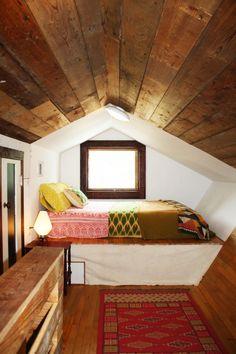 looks like an attic bedroom, cozy