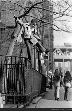 Neal Boenzi, On a tightrope high over Henry Street, 1974