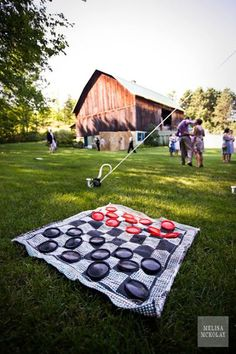 Reception Activities Yard Games: Oversized Board Games Creating a giant checkers board couldn't be easier — just get a checkered blanket and plastic plates or Frisbees in red and black. Backyard Games, Outdoor Games, Outdoor Fun, Backyard Ideas, Games For Kids, Games To Play, Giant Checkers, Outdoor Checkers, Play Checkers