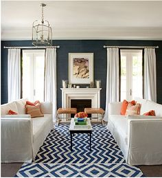 Love the contrasting colors. The key to this look would be the light from the windows so the blue walls don't seem too dark.