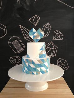 Colorful Geometric Wedding Cake With A Blue Geometric Heart Topper Modern Cakes, Unique Cakes, Creative Cakes, Pretty Cakes, Beautiful Cakes, Amazing Cakes, Fondant Figures, Fondant Cakes, Geometric Cake