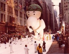 """Flying Ace Snoopy 1968 """"Snoopy"""" has come to be one of the most popular, if not the most famous float to ever be featured in the Macy's Thanksgiving Day Parade. Here's a look at the loveable """"Peanuts"""" character in the 1968 parade. Macys Thanksgiving Parade, Thanksgiving Parties, Mickey Balloons, Flying Ace, Snoopy And Woodstock, Historical Photos, Vintage Photos, Fun Facts, Nyc"""