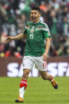 Oribe Peralta of Mexico celebrates after a goal during a match between Mexico and New Zealand as part of the FIFA World Cup Qualifiers at Azteca Stadium on November 13, 2013 in Mexico City, Mexico.