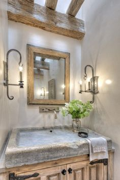 Rustic country bathroom with a shallow stone sink and exposed timber beams