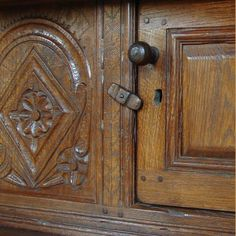 Example of finishing - detail of an oak court cupboard hand made in the workshops