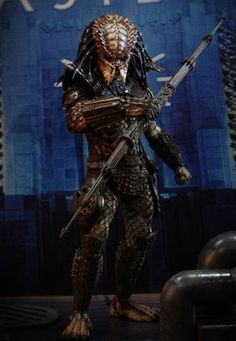 City Predator Figure from Predator 2. It is made by Hot Toys and is 1:6 scale (approx. 35cm / 13.8in high).  http://alien-predator.minimodelfilmstuff.co.uk/alien-predator/predator-predator-2-figure-hot-toys-901854 Hot Toys are proud to present the City Hunter Predator Sixth Scale Collectible Figure from the Predator 2 movie. The movie-accurate City Hunter Predator collectible is specially crafted based on his image in the movie, highlighting the newly developed head, LED light-...