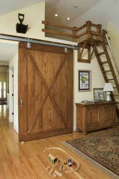 I love the idea of these large rolling doors.  Maybe between the great room and kitchen?  Not this rustic, though.