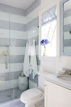 Gray and white bathroom, striped tile, glass door, white vanity, ceramic garden stool. Serene Bathroom, Beautiful Bathrooms, Design Bathroom, Modern Bathroom, White Bathroom, Bathroom Interior, Basement Bathroom, Small Bathroom, Bathroom Ideas