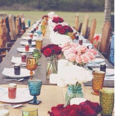 Eclectic glassware, low mason jar centerpieces, different chairs