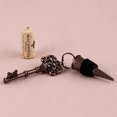 Placed atop bottles at the bar, on guests tables or as a favor, these totally chic key bottle stoppers are both functional and impressive. The rubber stopper fits snuggly in any standard size wine bot