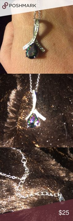 """Fashion costume necklace Beautiful greens no Purple Heart set under silver tone ribbon design. Gems trail along the bottoms of the ribbon. 2"""" extender included on necklace, comes with purple gift box in last pic. Jewelry Necklaces"""