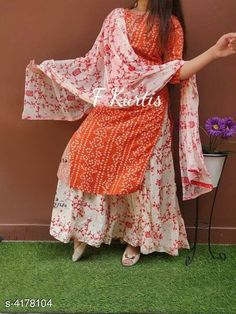 Dupatta Sets Prakhya Kurtis Women Rayon Bandhani Kurta Set with Skirt Kurta Fabric: Rayon Bottomwear Fabric: Cotton Dupatta Fabric: Mulmul Sleeve Length: Three-Quarter Sleeves Set Type: Kurta With Dupatta And Bottomwear Bottom Type: Skirt Pattern: Embroidered Multipack: Single Size: Kurta - M - 38 in L - 40 in XL - 42 in XXL - 44 in Bottom Size: M - 30 in L - 32 in XL - 34 in XXL - 36 in Dupatta Size: 2 Mtr Length: Kurta - Up To 40 in Skirt Length: Up To 40 in Country of Origin: India Sizes Available: 50, M, L, XL, XXL, 38, 40, 42, 44, 46, 48   Catalog Rating: ★4.1 (14281)  Catalog Name: Women Rayon A-line Printed Skirt Dupatta Set CatalogID_595611 C74-SC1853 Code: 865-4178104-0741