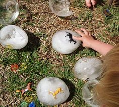 Ice eggs. Perfect for a fun cool down summer activity for the kids. They can discover ways to get to the small toys!! Fun ideas :)