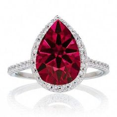 Pear Cut Ruby Halo Desiger Engagement for Woman. If you are looking for a Ruby gemstone engagement ring set at affordable prices then look no further than this beautiful Ruby and diamond wedding engagement ring. This ring can be customized to or gold. Ruby Wedding Rings, Custom Wedding Rings, Gemstone Engagement Rings, Ruby Rings, Gold Wedding, Wedding Bands, Bridal Rings, Solitaire Engagement, Wedding Tips