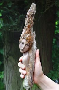 Bark and drift wood creatures. The head is made from polymer clay by doll maker Titjana Raum. German