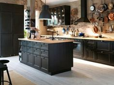 Inspiring Contemporary Kitchens with Black Cabinets Fabulous Industrial Kitchen Ideas With Black Cabinets And Large Island Using Wooden Countertop And Brick Wall
