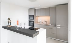 Stylish bulthaup b3 kitchens by hobsons choice, in Flint and Alpine White, were the only choice for this luxury apartment development in Bath, Somerset.