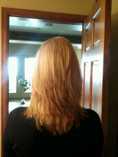 blonde layered hair. allover blonde and textured cut