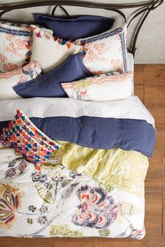 Tasseled Jacare Pillow - anthropologie.com/ Love the idea of the small multicoloured pillow. Need to do this in different colour blues.