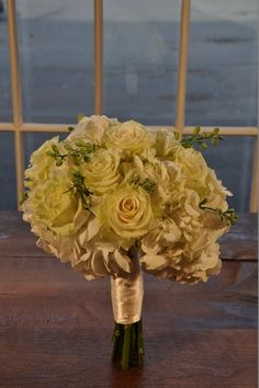 Wedding flowers -  wedding bridal bouquet-  Classic Ivory Collection Bridal Bouquet.  Lush ivory and white bouquet brimming with hydrangea, roses and hints of white larkspur add a touch of contrasting green.  Wrapped in a luxurious double faced satin ribbon or burlap and lace and finished with the pins of your choice. For more pictures and pricing visit our website  https://www.theflowerstudioct.com