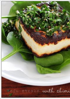 The perfect dinner for tired and hungry cooks. As the weather turns colder here in the NE this marinade will heat you up. Tofu Steaks with Chimichurri and Baby Spinach. TAKES 10 MINUTES! Yummm #glutenfree #vegan