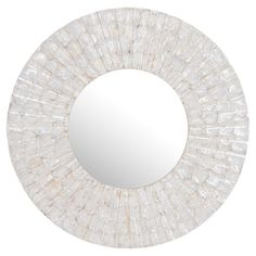 "Showcasing a chic glass frame and circular silhouette, this eye-catching wall mirror creates a stylish focal point in your living room or hallway. Construction Material: Placuna placenta, wood and mirrored glass Color: Silver frame Features: Scratch resistant Dimensions: 32"" Diameter"
