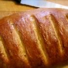 """""""Whole wheat bread with sunflower seeds, cracked wheat, and honey.""""  less than 100 calories per serving. Looks like it makes 6 loaves (12 slices per loaf)"""
