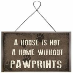 """Whether displayed on its own or as part of an eye-catching collage, this hanging giclee print charms with a pet-themed typographic motif and paw print details.   Product: Wall decorConstruction Material: Paper and MDFDimensions: 7"""" H x 10"""" W x 0.75"""" D Note: Dimensions do not include hanger"""