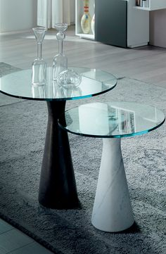 Litro is a stunning coffee table designed by Studio 28 for Cattelan Italia. With feet in matt Ebano marble or white Carrara and top in matt Ebano marble, white Carrara or tempered 10 mm clear glass.