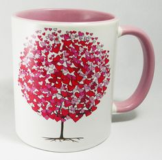 Pink Tree of Hearts Mug with pink glazed handle and inner. Designed and printed in Britain. A high quality ceramic mug which is both dishwasher and microwave proof. Height 9.5cm Diameter 8.2 cm, with a capacity of 310ml (11oz)). From the Series 1 Original Line Range by Half A Donkey www.halfadonkey.co.uk
