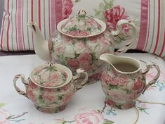 A desirable vintage teapot set with matching lidded sugar bowl and milk jug. Decorated all over with beautiful pink roses against a stone coloured background with hand painted details on the spout and handles. This vintage set shows no makers mark on the base. The set is in great