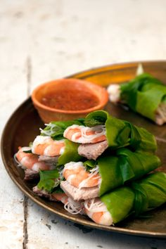 """Vietnamese Lettuce Wraps """"A fragrant and satisfying appetizer (as well as an excellent use for leftover roast pork and poached or steamed shrimp), these flavorful bundles are great dipped in nuoc cham, a sweet and spicy Vietnamese sauce.""""-makes 20 small wraps  #SaveurRecipes #Saveur"""