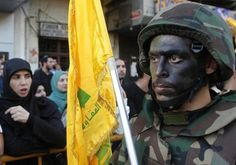 Lebanese Hezbollah supporters march during a religious procession, to mark the burning of the tents that is part of the Ashura religious ceremony, in Nabatieh November 7, 2014.  REUTERS/Ali Hashisho (LEBANON - Tags: POLITICS RELIGION) - RTR4DAZY