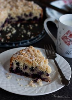 Lemon Blueberry Coffee Cake - Tender, moist lemon coffee cake loaded with blueberries crowned with a crunchy, sweet crumb topping and drizzled with a tart lemon glaze.